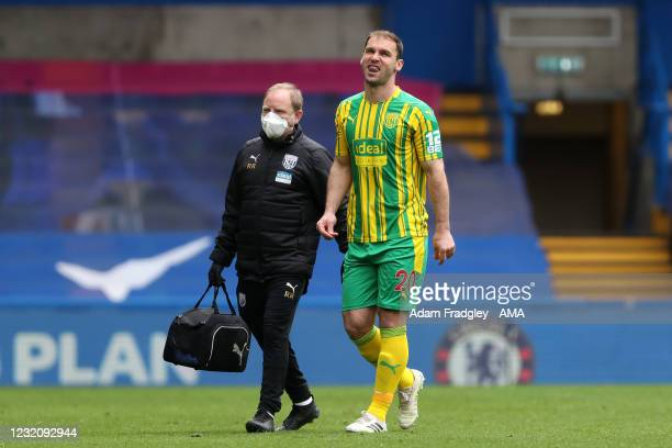Branislav Ivanovic of West Bromwich Albion is forced off injured after coming on as a substitute replacing the injured Dara O'Sheaduring the Premier...