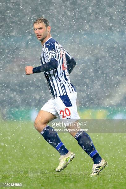 Branislav Ivanovic of West Bromwich Albion looks through the snow during the Premier League match between West Bromwich Albion and Arsenal at The...