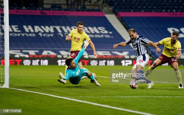 Branislav Ivanovic of West Bromwich Albion shoots under pressure from Erik Pieters of Burnley during the Premier League match between West Bromwich...