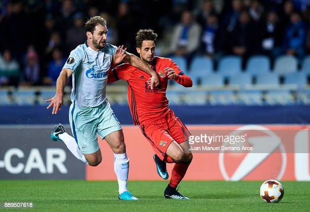 Branislav Ivanovic of Zenit St Petersburg duels for the ball with Adnan Januzaj of Real Sociedad during the UEFA Europa League group L football match...