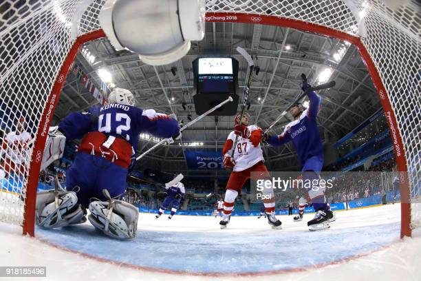 Branislav Konrad and Tomas Surovy of Slovakia compete for a loose puck with Vadim Shipachyov of Olympic Athlete from Russia in the second period...