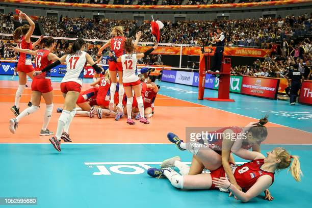 Brankica Mihajlovic of Serbia celebrates with teammate Tijana Malesevic after winning the Champion Point during the FIVB Women's World Championship...