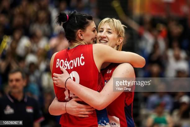 Brankica Mihajlovic of Serbia hugs her teammate Tijana Boskovic during the FIVB Women's World Championship final between Serbia and Italy at Yokohama...