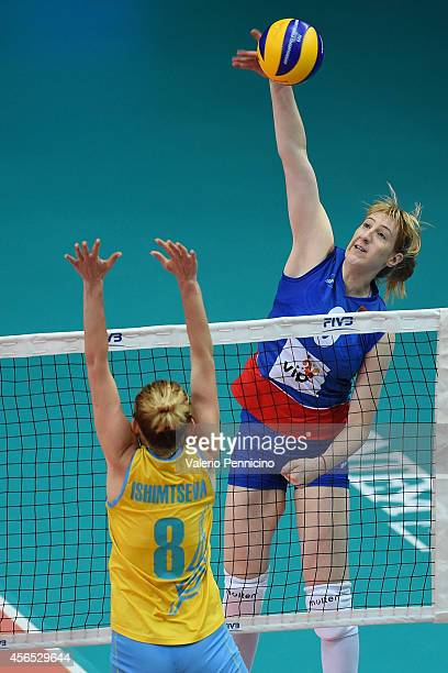 Brankica Mihajlovic of Serbia spikes as Korinna Ishimtseva of Kazakhstan blocks during the FIVB Women's World Championship pool F match between...