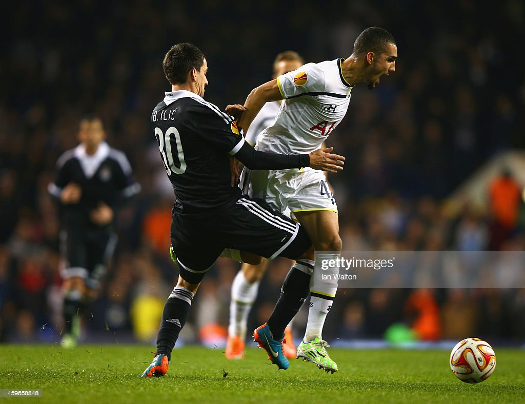 Branko Ilic of Partizan Belgrade tackles Nabil Bentaleb of Spurs during the UEFA Europa League group C match between Tottenham Hotspur FC and FK Partizan at White Hart Lane on November 27, 2014 in London, United Kingdom.