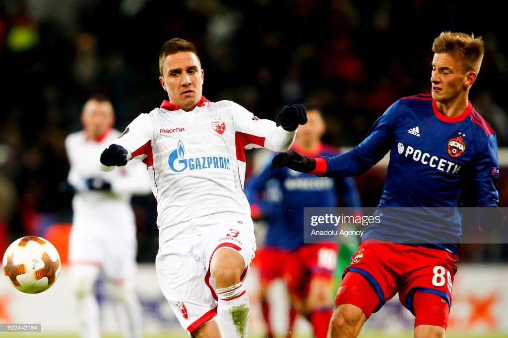 Branko Jovicic (L) of Crvena Zvezda in action against Konstantin Kuchaev (R) of CSKA Moscow during the UEFA Europa League round of 32, second leg soccer match between CSKA Moscow and Crvena Zvezda at the Stadium CSKA Moscow in Moscow, Russia on February 21, 2018.