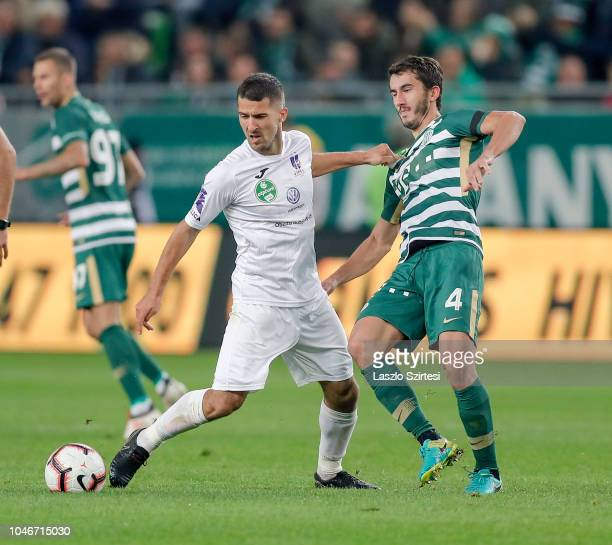 Branko Pauljevic of Ujpest FC competes for the ball with Stefan Spirovski of Ferencvarosi TC during the Hungarian OTP Bank Liga match between...