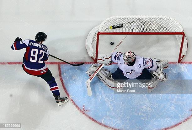 Branko Radivojevic of Slovakia scores his team's 4th goal over Cristobal Huet , goaltender of France during the IIHF World Championship group H match...