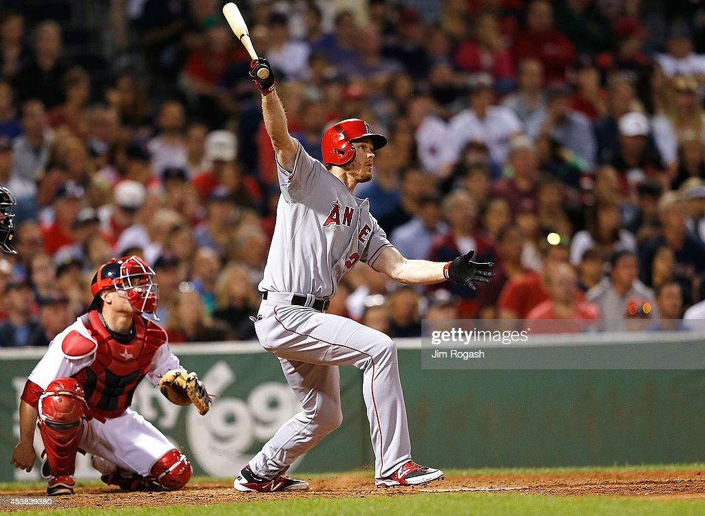 Brannan Boesch #28 of the Los Angeles Angels of Anaheim doubles in the ninth inning against the Boston Red Sox at Fenway Park on August 19, 2014 in Boston, Massachusetts.