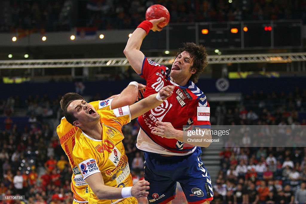 Bransilav Angelovski and Vladimir Temelkov of Macedonia defend against Momir Rnic of Serbia (R) during the Men's European Handball Championship second round group one match between Serbia and Macedonia at Beogradska Arena on January 25, 2012 in Belgrade, Serbia.