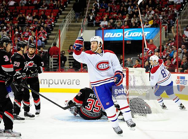 Branson Prust of the Montreal Canadiens scores a goal against Justin Peters of the Carolina Hurricanes during the first period at PNC Arena on March...