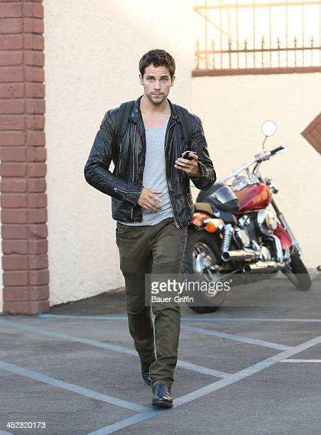 Brant Daugherty leaves on his motorcycle after rehearsals for Dances with the Stars on September 20 2013 in Los Angeles California
