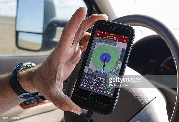 Brant Peterson uses his iPhone to check his irrigation pivots in his farm on June 10 2015 in Stanton County Kan Peterson says he's noticed that the...