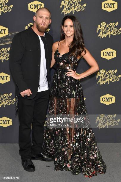 Brantley Gilbert and Amber Cochran attend the 2018 CMT Music Awards at Bridgestone Arena on June 6 2018 in Nashville Tennessee