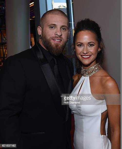 Brantley Gilbert and Amber Cochran attend the 50th annual CMA Awards at the Bridgestone Arena on November 2 2016 in Nashville Tennessee
