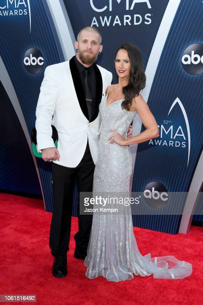 Brantley Gilbert and Amber Cochran attend the 52nd annual CMA Awards at the Bridgestone Arena on November 14 2018 in Nashville Tennessee