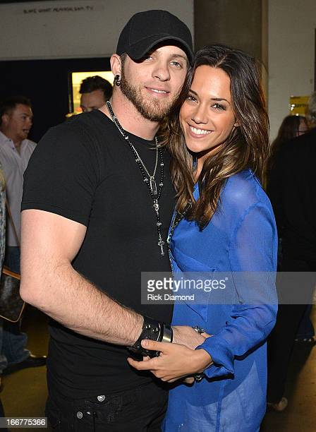 Brantley Gilbert and Jana Kramer backstage during Keith Urban's Fourth annual We're All For The Hall benefit concert at Bridgestone Arena on April 16...