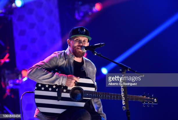 Brantley Gilbert performs onstage at iHeartCountry One Night For Our Military Presented By The Makers of AccuChek Guide at iHeartRadio Theater on...