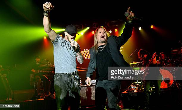 Brantley Gilbert performs with Motley Crue's Vince Neil at the 2014 Big Machine Label Group Show At Country Radio Seminar on February 19 2014 in...