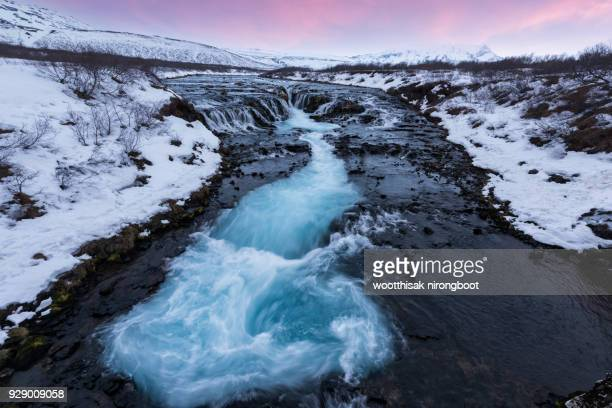 brúarfoss waterfall in winter - tectonic stock photos and pictures