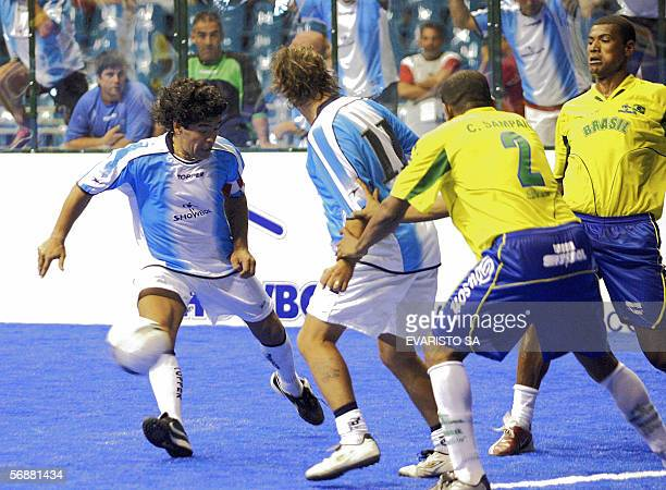 Argentine player Diego Maradona tries to avoid Brazilians Cesar Sampaio and Junior Baiano in an exhibition Showball game between Argentina and Brazil...