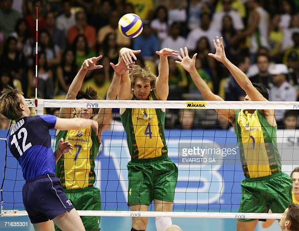 Brazil's Gilberto Godoy Andre Heller and Andre Nascimento try to block an atack from Finland's Olli Kunnari during their 2006 World League volleyball...