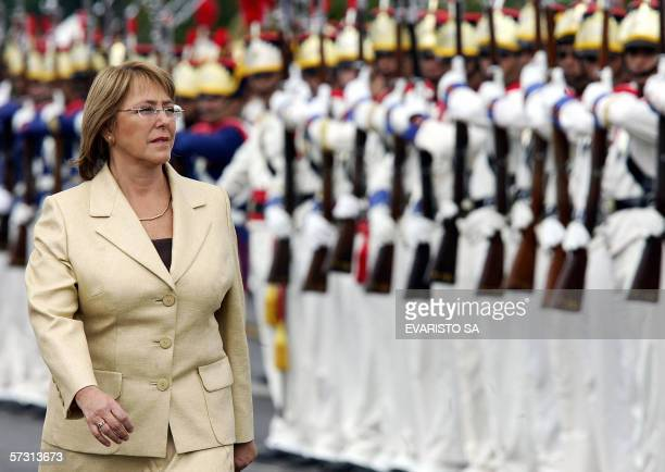 Chilean President Michelle Bachelet reviews troops upon her arrival at Planalto palace in Brasilia, 11 April 2006. Bachellet is in Brazil to meet...