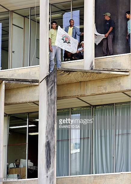 Members of the Brazilian trade union Federation of Workers in Family Farming demonstrate on the cornice of the National Highway Departament building...