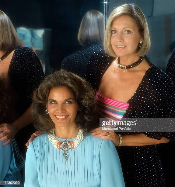 Brasilian actress Florinda Bolkan and French actress Catherine Spaak posing for a photograph the latter keeping her hands on the other woman's...