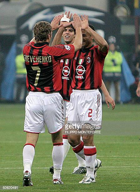 Brasilian Cafu and Kaka of AC Milan celebrates with Ukranian Andrij Shevchenko after he scored the first goal against InterMilan during quarter final...