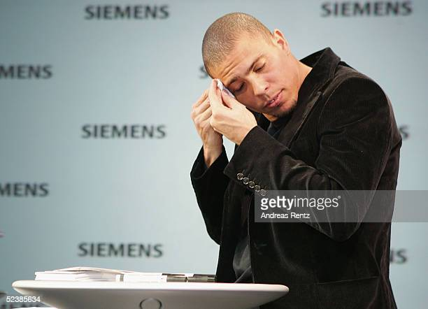 Brasilian football player, Ronaldo, gestures as he attends the CeBIT technology trade fair March 14, 2005 in Hanover, Germany. CeBIT, the biggest...