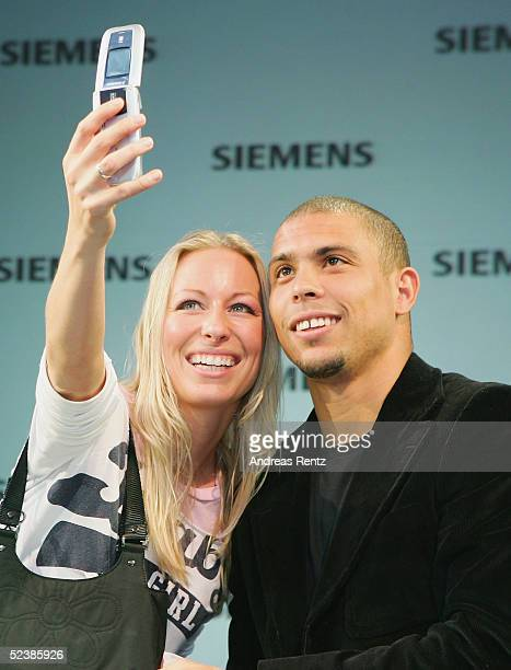 Brasilian football player, Ronaldo, has his picture taken by an unidentified member of the public as he attends the CeBIT technology trade fair March...