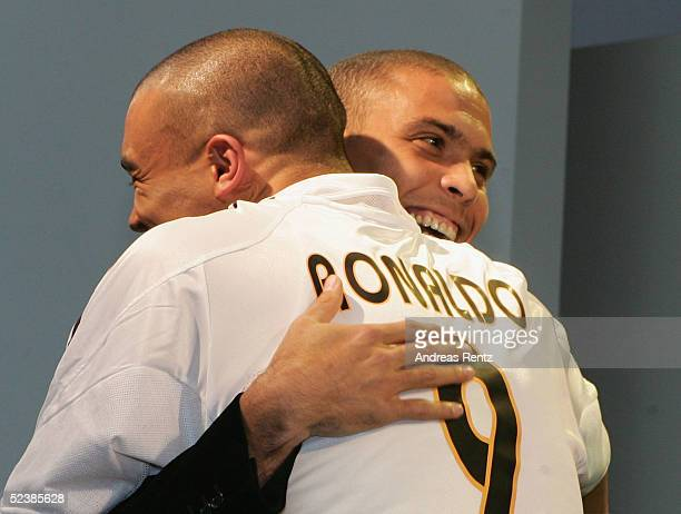 Brasilian football player, Ronaldo, hugs fan Hakim Darouiche as they attend the CeBIT technology trade fair March 14, 2005 in Hanover, Germany....
