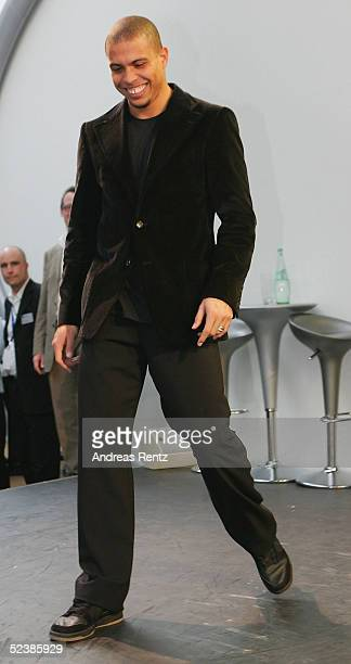Brasilian football player, Ronaldo, in buoyant mood at the Siemens mobile stand as he attends the CeBIT technology trade fair March 14, 2005 in...