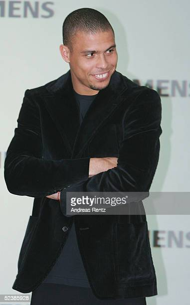 Brasilian football player Ronaldo poses at the Siemens mobile stand as he attends the CeBIT technology trade fair March 14 2005 in Hanover Germany...