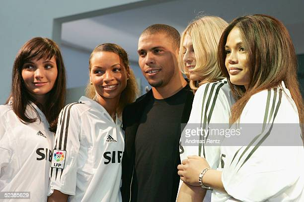 Brasilian football player, Ronaldo, stands with Siemens mobile hostesses as they attend the CeBIT technology trade fair March 14, 2005 in Hanover,...