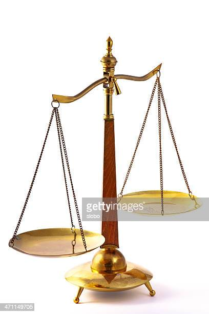 Brass and wood scales of justice, tipping to one side.