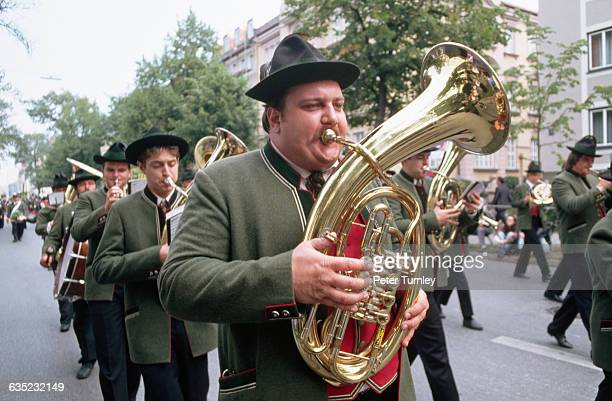 A brass band marches to the Oktoberfest grounds during the morning procession