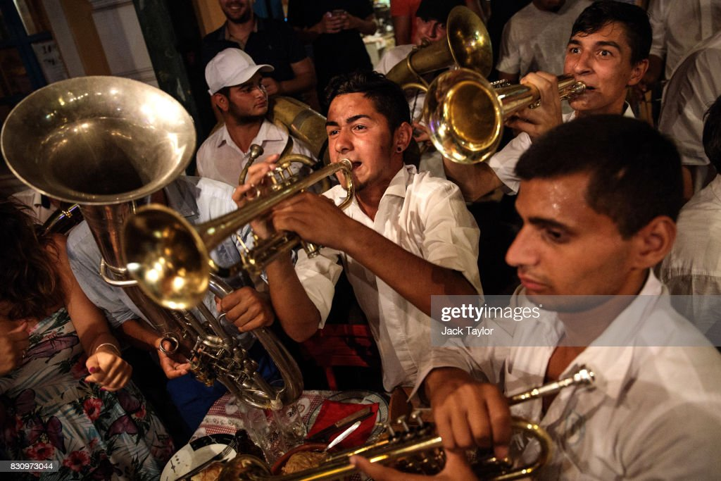 A brass band performs in a restaurant during the Guca Trumpet Festival on August 11, 2017 in Guca, Serbia. Thousands of revellers attend the trumpet festival, held annually since 1961 in the small, central Serbian town of Guca. The free event is a celebration of Balkan music with dozens of orchestras and solo trumpeters taking part in the festival's main competition. During the festival wild street parties take place throughout the night as brass bands parade and play for tips to the thousands of visitors in the town's restaurants, bars and pop-up tents.