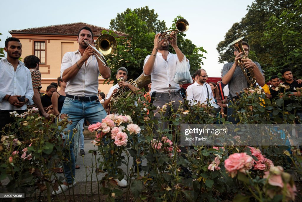 A brass band performs in the town centre during the Guca Trumpet Festival on August 11, 2017 in Guca, Serbia. Thousands of revellers attend the trumpet festival, held annually since 1961 in the small, central Serbian town of Guca. The free event is a celebration of Balkan music with dozens of orchestras and solo trumpeters taking part in the festival's main competition. During the festival wild street parties take place throughout the night as brass bands parade and play for tips to the thousands of visitors in the town's restaurants, bars and pop-up tents.
