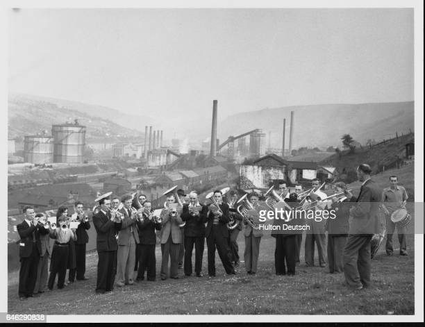 A brass band plays in front of the steel works in Ebbw Vale Wales