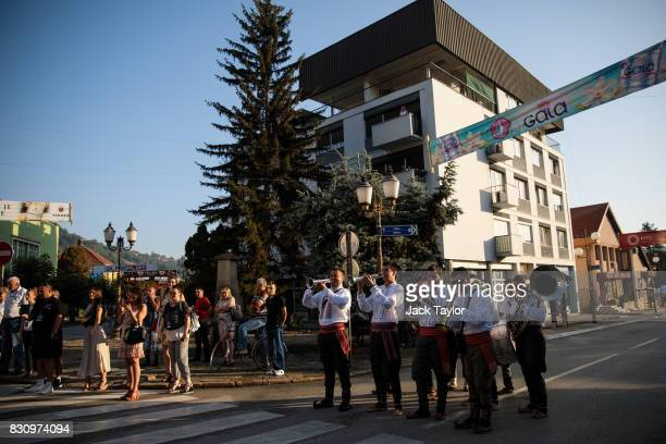 A brass band plays in the streets for the wakening call of the trumpeters during the Guca Trumpet Festival on August 11 2017 in Guca Serbia Thousands...