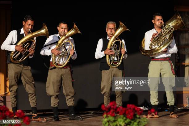 A brass band plays on a stage for the wakening call of the trumpeters during the Guca Trumpet Festival on August 11 2017 in Guca Serbia Thousands of...