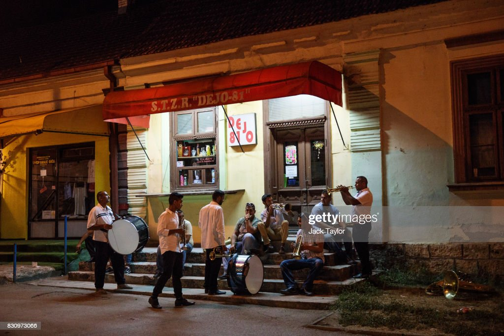 A brass band relaxes on some steps outside of a closed shop during the Guca Trumpet Festival in the early hours on August 10, 2017 in Guca, Serbia. Thousands of revellers attend the trumpet festival, held annually since 1961 in the small, central Serbian town of Guca. The free event is a celebration of Balkan music with dozens of orchestras and solo trumpeters taking part in the festival's main competition. During the festival wild street parties take place throughout the night as brass bands parade and play for tips to the thousands of visitors in the town's restaurants, bars and pop-up tents.