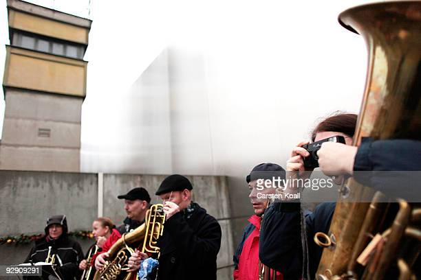 A brass band waits to play at a commemorative ceremony at a stillexisting section of the Berlin Wall at the Bernauer Strasse memorial on the 20th...