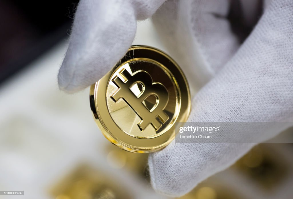 A brass bitcoin medal produced by Sakamoto Metal is displayed at the company's workshop on January 25, 2018 in Tokyo, Japan. Sakamoto Metal, a custom medal, coin and pin badge maker in Tokyo, produces 24K gold and brass bitcoin medals that went on sale in January as investments in cryptocurrencies become popular in the country after Japan's government passed a law recognising bitcoin and other alternative coins as legal tender in 2017.