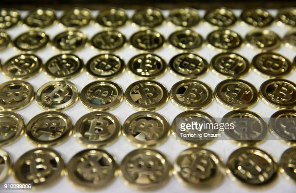 Brass bitcoin medals produced by Sakamoto Metal are seen at a workshop on January 25 2018 in Tokyo Japan Sakamoto Metal a custom medal coin and pin...
