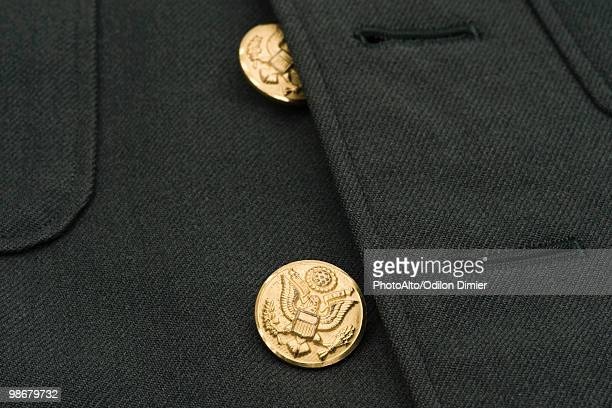 Brass buttons of military dress uniform jacket