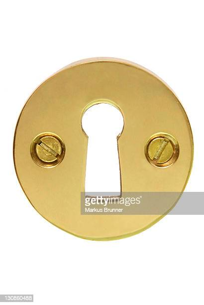 Brass coloured fitting for a keyhole