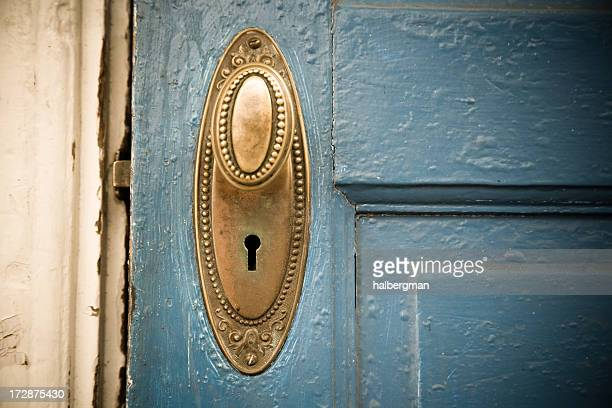 Brass Doorknob on a Blue Door
